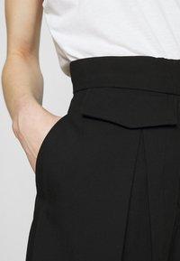 Weekday - NIGELLA TROUSERS - Pantalones - black - 4