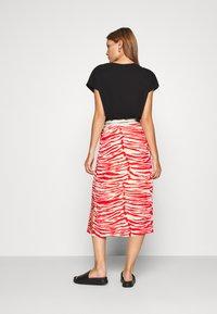 Calvin Klein - ZEBRA PRINT LOGO SKIRT - A-line skirt - red - 2