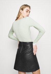 Vero Moda - VMPARIS SHORT SKIRT  - Mini skirt - black - 4