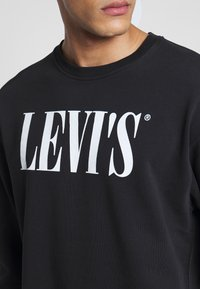 Levi's® - RELAXED GRAPHIC CREWNECK - Sweatshirt - black - 5