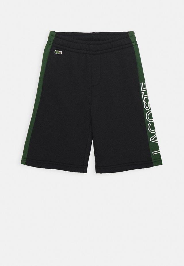 UNISEX - Sports shorts - abysm/green/white