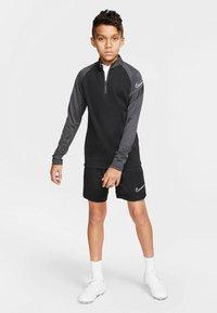 Nike Performance - Long sleeved top - schwarz/grau (718) - 1
