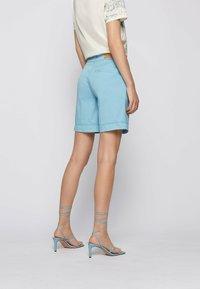 BOSS - TAGGIE - Shorts - light blue - 2