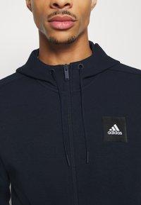 adidas Performance - MUST HAVES ENHANCED SPORTS HOODED TRACK - veste en sweat zippée - legink/legink - 6