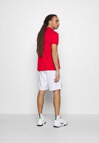 Nike Performance - Sports shorts - white/black - 2
