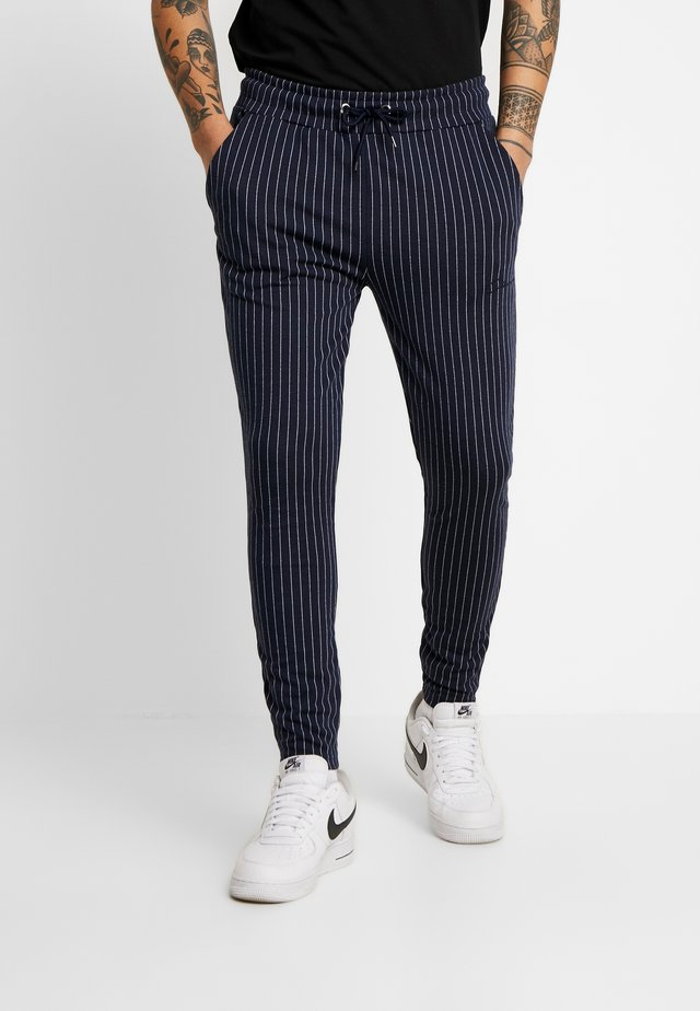 PIN STRIPE - Tracksuit bottoms - navy