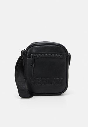 SOFT BAG UNISEX - Across body bag - black
