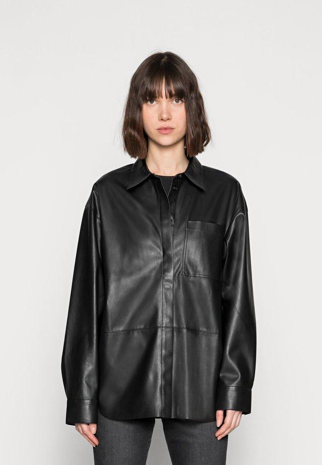 OVERSHIRT - Faux leather jacket - black