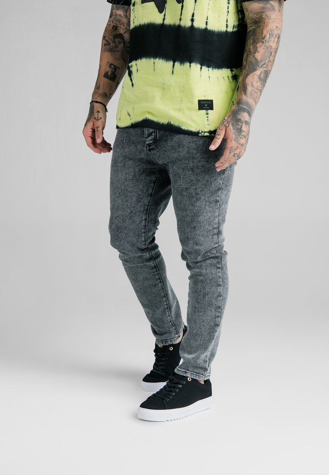 STEVE AOKI X  - Jeans slim fit - acid black