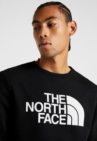 The North Face - CANYONWALL CREW - Felpa - black/deep garnet red