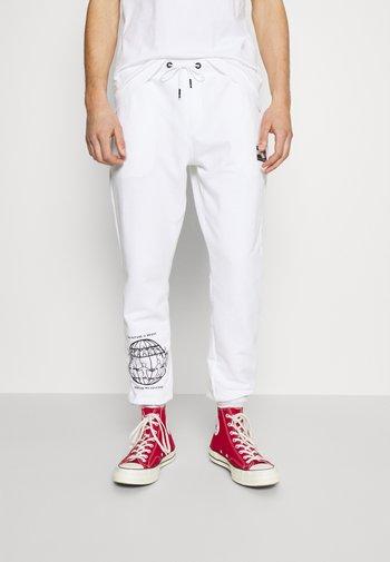 ONE PLANET UNISEX - Pantalon de survêtement - white