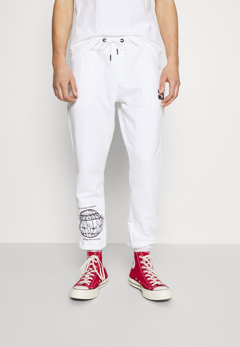 Tommy Hilfiger - ONE PLANET UNISEX - Tracksuit bottoms - white