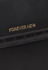Forever New - VERA BORDER CROSSBODY BAG - Across body bag - black - 3