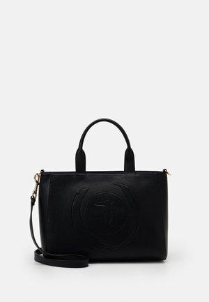 FAITH SATCHEL WITH TASSLE - Across body bag - black