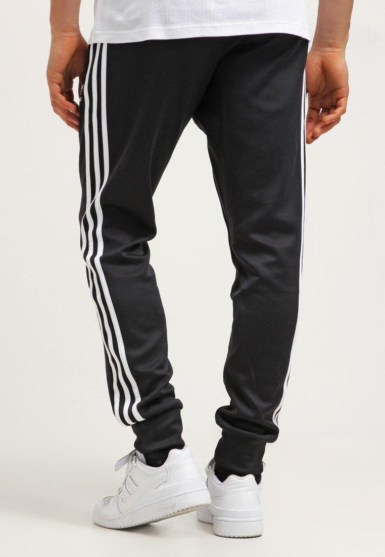 Preguntar Alienación fuerte  adidas Originals SUPERSTAR - Pantalon de survêtement - black/noir -  ZALANDO.FR