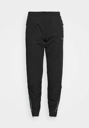 TIRILL PANT - Tracksuit bottoms - black