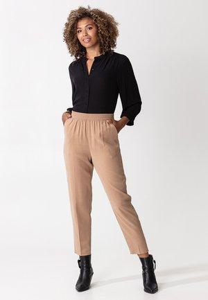 DANIE - Trousers - beige