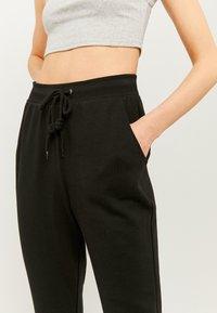 TALLY WEiJL - Teplákové kalhoty - black - 3