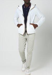 K-Way - CLAUDE 3.0 UNISEX  - Summer jacket - white - 0