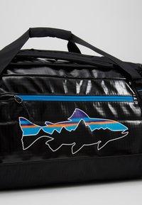 Patagonia - BLACK HOLE DUFFEL 55L UNISEX - Sports bag - black - 9