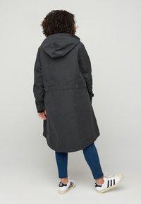 Zizzi - VERSTELLBARER - Waterproof jacket - black - 2