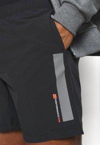 Jack & Jones - JCORUNNING SHORTS  - Sports shorts - black - 4