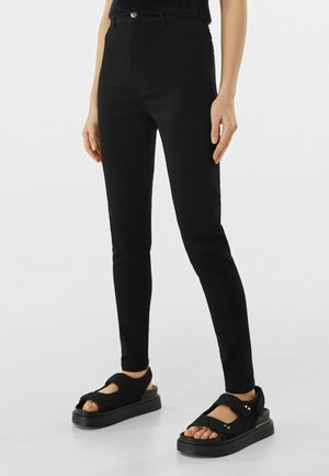 SUPER HIGH WAIST - Slim fit jeans - black
