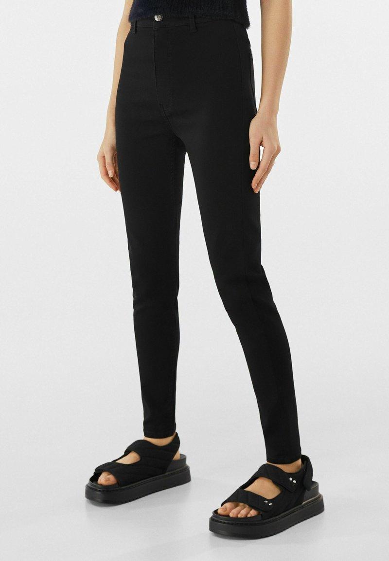 Bershka - SUPER HIGH WAIST - Slim fit jeans - black