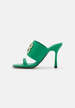 Heeled mules - green