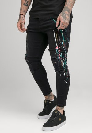 RIPPED RIOT  - Vaqueros pitillo - washed black