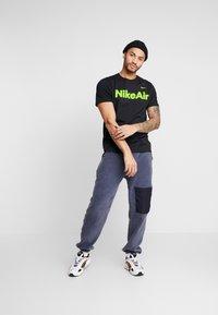 Nike Sportswear - AIR TEE - Print T-shirt - black/volt - 1