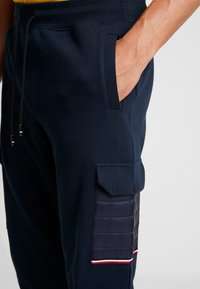 Tommy Hilfiger - MIXED MEDIA - Tracksuit bottoms - blue - 3