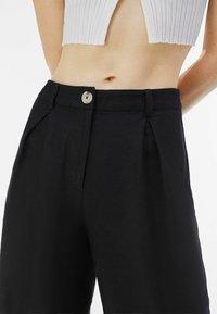 Bershka - Trousers - black - 3
