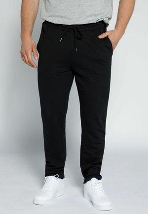REGULAR FIT - Pantalon de survêtement - schwarz
