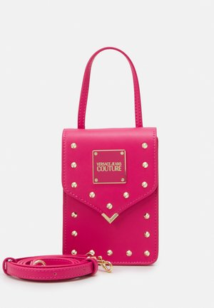 STUDS REVOLUTION CROSSBODY - Handbag - fuxia