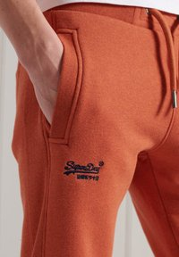 Superdry - ORANGE LABEL CLASSIC  - Tracksuit bottoms - rust orange marl - 2