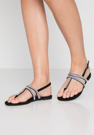 WIDE FIT FARAWAY T-BAR TOEPOST - Sandalias de dedo - black