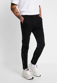 Good For Nothing - FUTURE PANT - Pantalon de survêtement - black - 0
