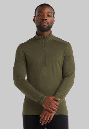 Stickad tröja - loden