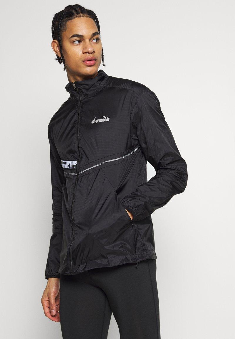 Diadora - LIGHTWEIGHT WIND JACKET BE ONE - Sports jacket - black