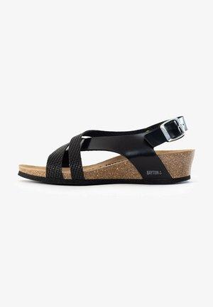 LUCENA - Wedge sandals - black