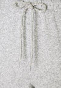 Pieces - PCCHILLI PANTS - Tracksuit bottoms - light grey melange - 2
