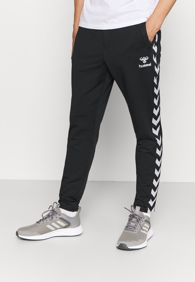 NATHAN TAPERED PANTS - Tracksuit bottoms - black