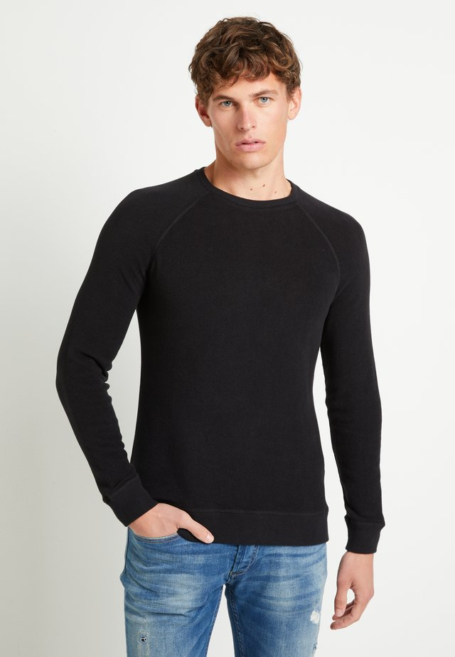 RAGLAN CREW - Jumper - black
