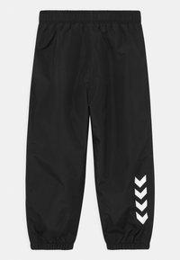 Hummel - TARO UNISEX - Rain trousers - black - 1