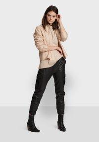 Oakwood - CARGO - Leather trousers - black - 1