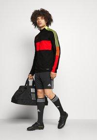 adidas Performance - TIRO - Träningsjacka - black/red - 1