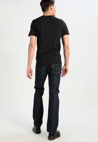 Levi's® - GRAPHIC SET-IN NECK - T-shirt print - graphic black - 2