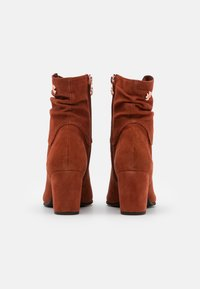 Marco Tozzi by Guido Maria Kretschmer - Classic ankle boots - brick - 3