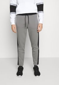 Calvin Klein - SOLID MIX BACK LOGO PANTS - Tracksuit bottoms - grey - 0